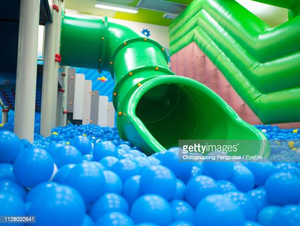 blue balls and slide - slide play equipment stock pictures, royalty-free photos & images