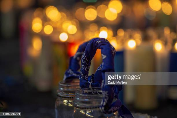 Blue bandanas a symbol of the Crips gang are seen in one of the makeshift memorials as people mourn the murder of Nipsey Hussle on April 1 2019 in...