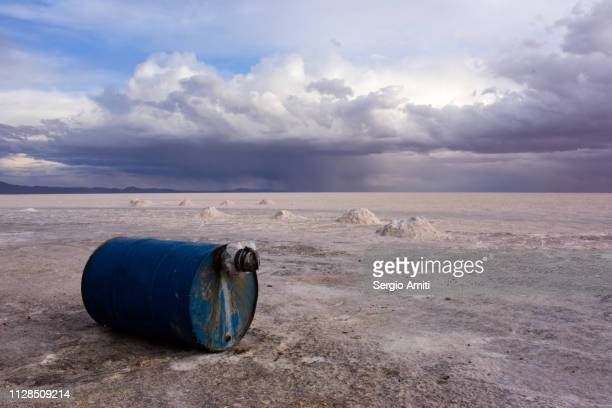 Blue barrel under dramatic cloudy sky at Uyuni Salt Flats