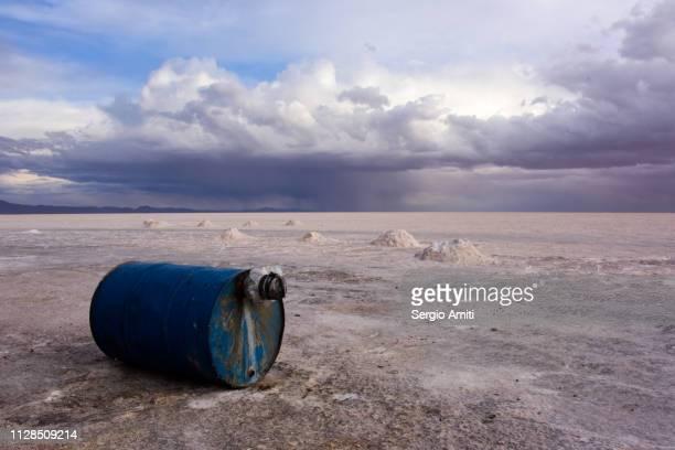 Blue barrel under dramatic cloudy sky at Uyuni Salt Flats
