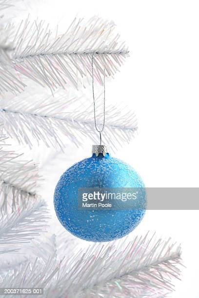 Blue bauble decoration on Christmas tree, close up