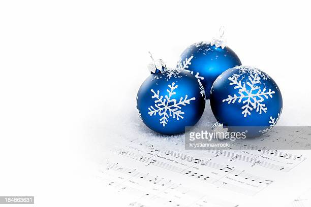 blue baubles on sheet notes with christmas carols - christmas music stock pictures, royalty-free photos & images