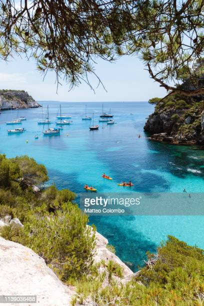 blue bay in summer, menorca, balearic islands, spain - islas baleares fotografías e imágenes de stock