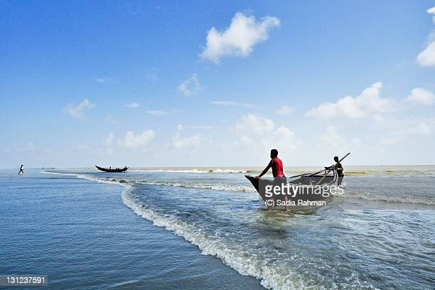 blue beach - fishing in bangladesh stock photos and pictures