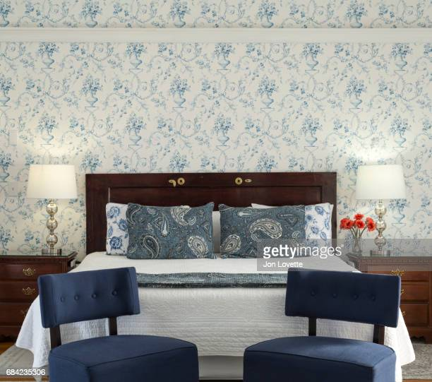 Blue bedroom with chairs