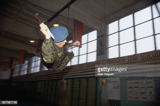A Blue Berets paratrooper practices jumping and throwing a bayonet during training in Gaiziunai Lithuania The Blue Berets are the airborne troops...