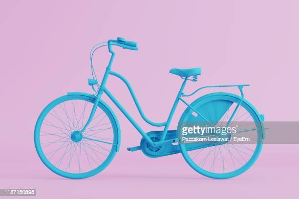 blue bicycle against pink background - wheel stock pictures, royalty-free photos & images
