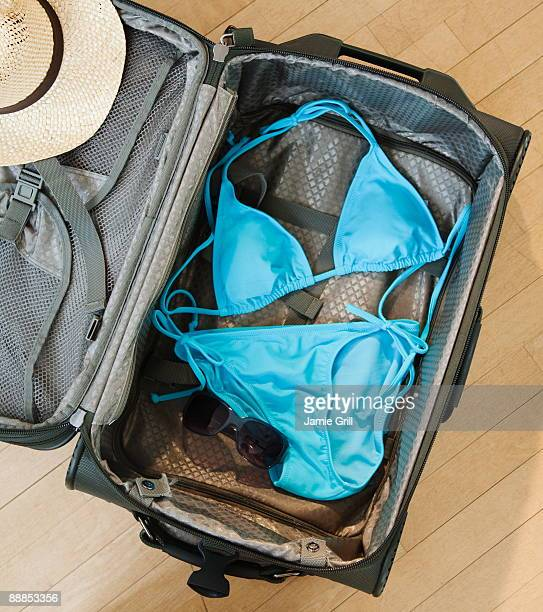 Blue bikini in suitcase