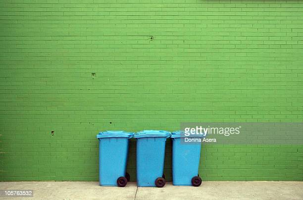 blue bins - garbage can stock photos and pictures