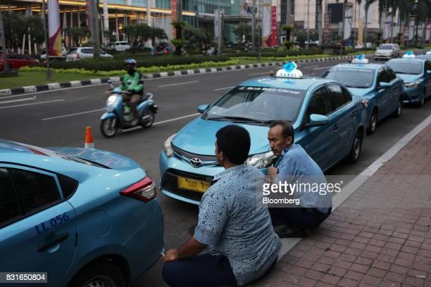 PT Blue Bird taxi drivers wait for fares in Jakarta Indonesia on Sunday Aug 13 2017 PresidentJokoWidodois seeking hundreds of billions of dollars...