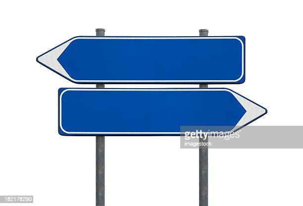 Blue blank directional sign posts