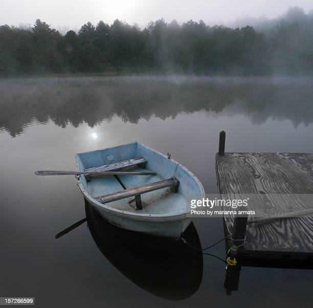 Blue boat at sunrise