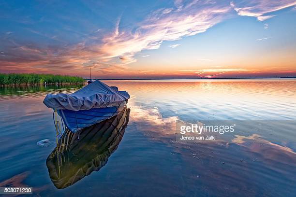 Blue boat at sunset