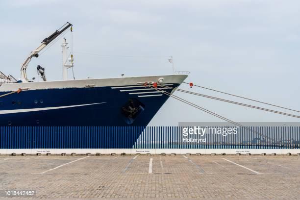 Blue boat docked in the harbor of Cadiz, Spain