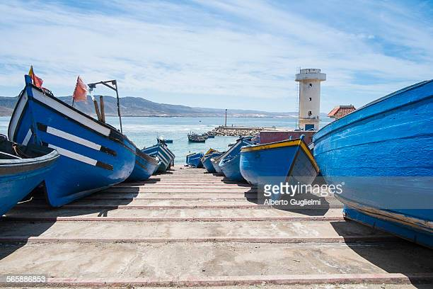 Blue boats docked on boat ramp