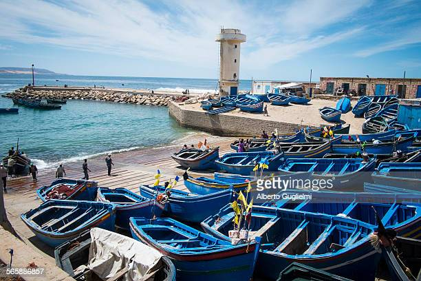 blue boats docked on boat ramp - agadir stock pictures, royalty-free photos & images