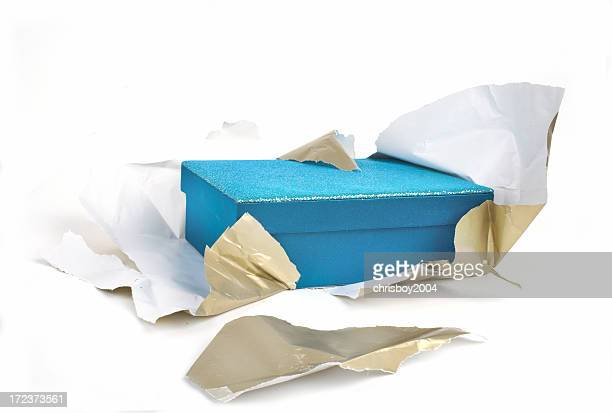 A blue box half unwrapped from gold paper