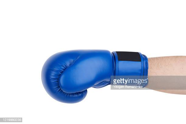 blue boxing glove on men's hand isolated on white - sports glove stock pictures, royalty-free photos & images