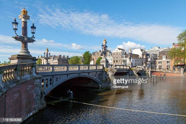 blue bridge in amsterdam - gwengoat stock pictures, royalty-free photos & images