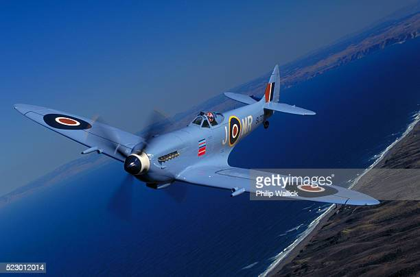 blue british spitfire fighter plane - spitfire stock pictures, royalty-free photos & images