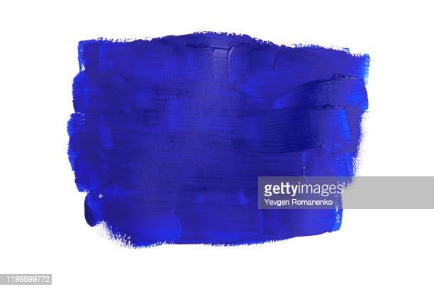 blue brush stroke isolated on white background - farbklecks stock-fotos und bilder