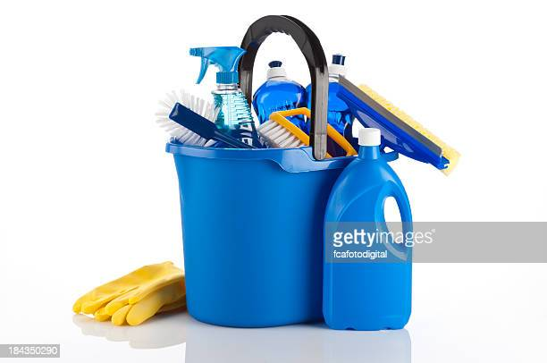 A blue bucket containing cleaning items and yellow gloves