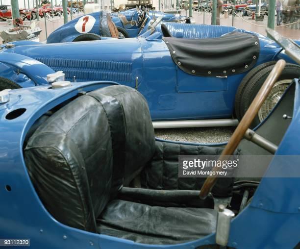 A blue Bugatti in the showroom circa 1990