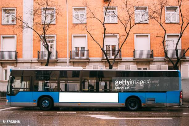blue bus at street - side view stock pictures, royalty-free photos & images