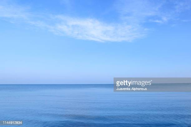 blue calm seas - horizon over water stock pictures, royalty-free photos & images