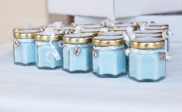 Blue candles in glass jars for a baptism ceremony
