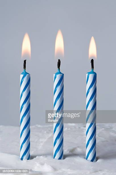 Blue candles on cake, close-up