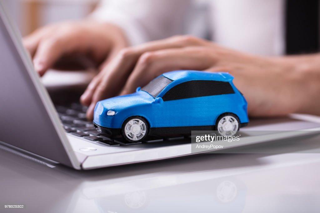 Blue Car On Laptop Keypad : Stock Photo