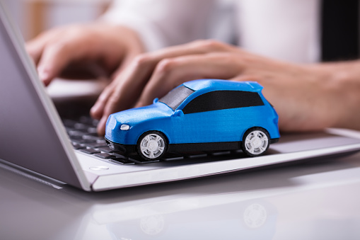 Blue Car On Laptop Keypad 978525302