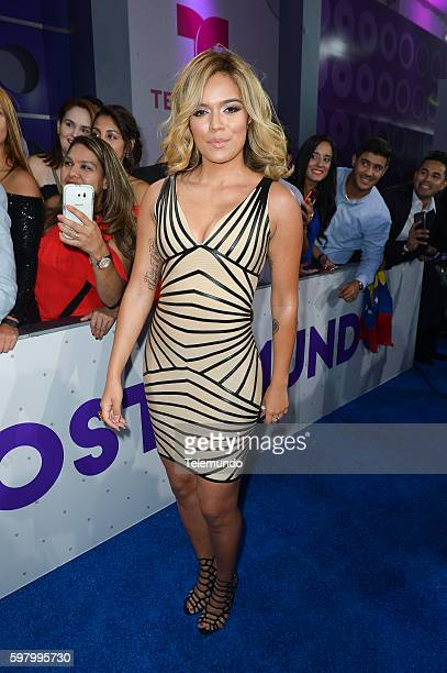 MUNDO 2016 'Blue Carpet' Pictured Karol G arrives at the 2016 Premios Tu Mundo at the American Airlines Arena in Miami Florida on August 25 2016