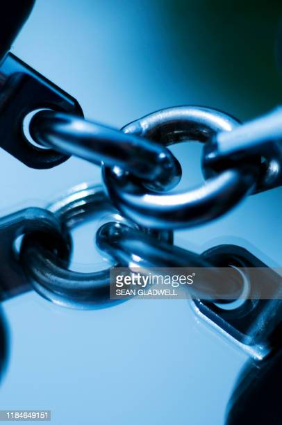 blue chain link - chain stock pictures, royalty-free photos & images
