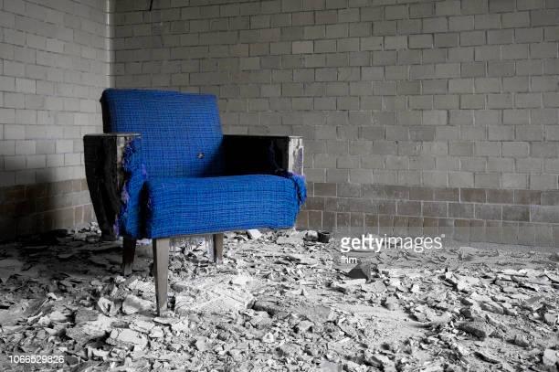 blue chair in an old room - escombros fotografías e imágenes de stock