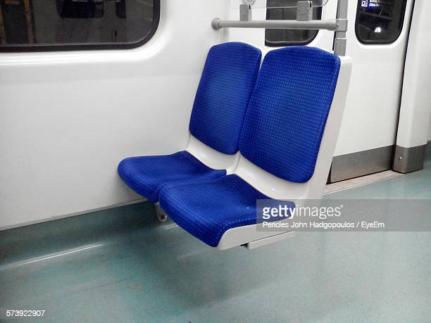 Blue Chairs In Subway Train