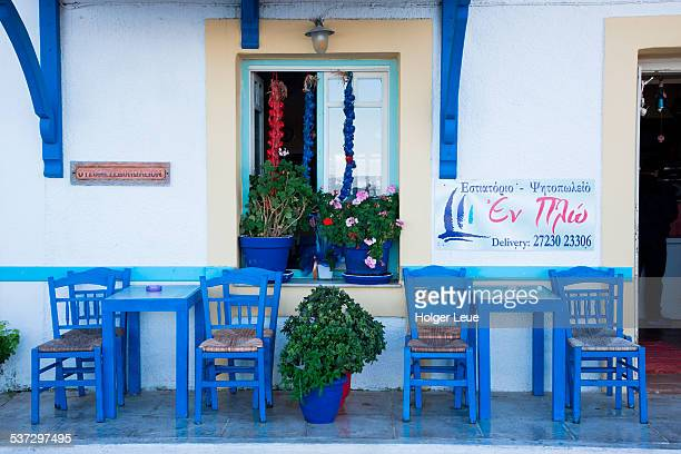 Blue chairs outside taverna bar and resturant