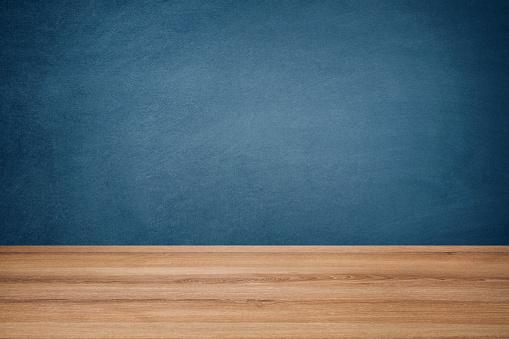 Blue Chalkboard and Wooden Floor 1030479058