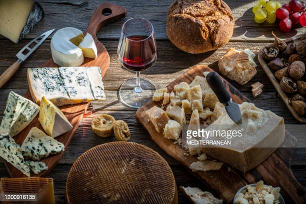 blue cheese manchego and parmigliano reggiano - chestnut food stock pictures, royalty-free photos & images