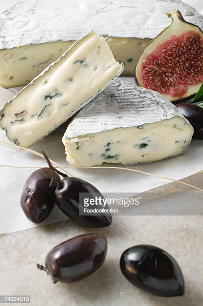 Blue cheese with pieces cut, half a fig and olives