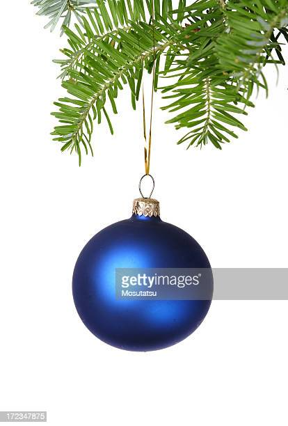 Blue Christmas ball hanging from a Christmas tree branch