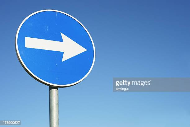 blue, circular right turn traffic sign - road sign stock pictures, royalty-free photos & images