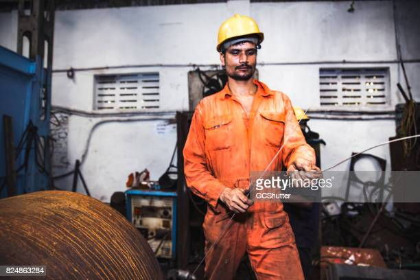 Blue collar employee working in a factory