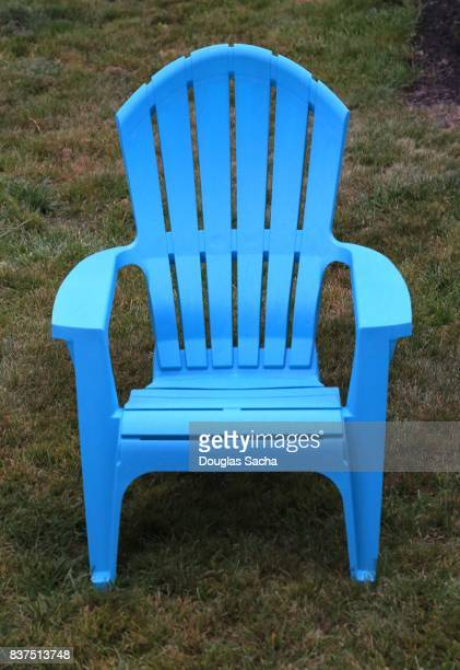 Blue colored Adirondack chair on the grass