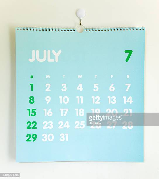 blue colored  calendar on white wall