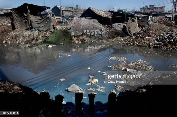 Blue colored dye and chemicals are emptied out of a leather tannery and into a canal that empties out into the Buriganga river November 11 2013 in...