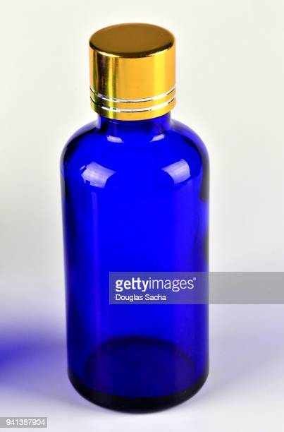 Blue colored Essential Oil health bottle on a white background