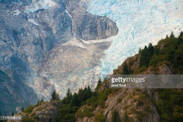 a blue colored hanging glacier in kenai fjords national park, alaska - golfo do alasca imagens e fotografias de stock
