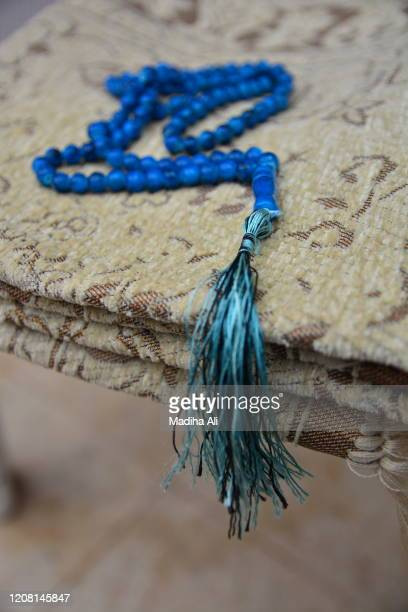 blue colored muslim tasbih / tasbeeh prayer beads, used in islam to remember allah - jewish prayer shawl stock pictures, royalty-free photos & images